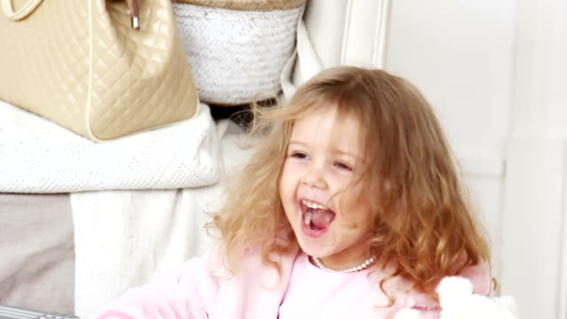 Charming little girl laughing happily video