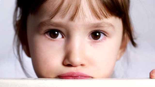Charming Little Girl Charming little girl sideways glance stock videos & royalty-free footage