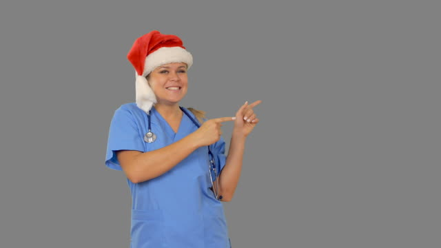 Charming young nurse dancing and showing copy space