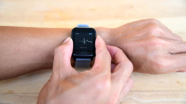 Check ECG by smartwatch / Check Heart rate by Smartwatch The man Check ECG by smartwatch / Check Heart rate by Smartwatch wearable computer stock videos & royalty-free footage
