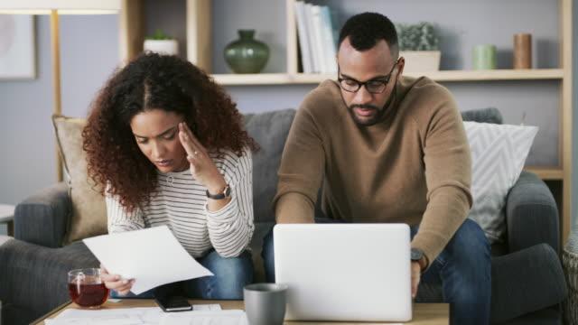 vídeos de stock e filmes b-roll de check out our website for all your debt solutions - bills couple