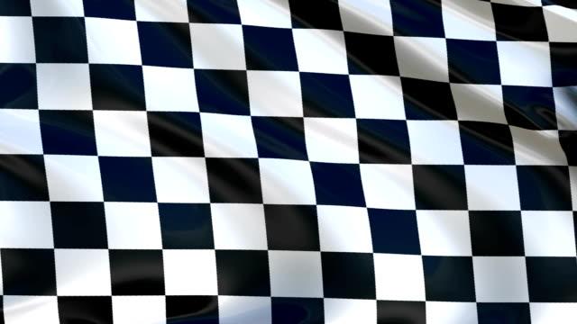 vídeos de stock e filmes b-roll de checkered flag flying in the wind, in the sport to the finish.  cyclic animation. - quadriculado