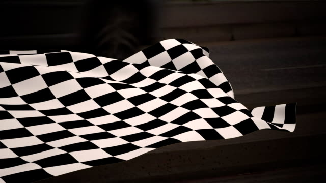 Checkered flag waving against road