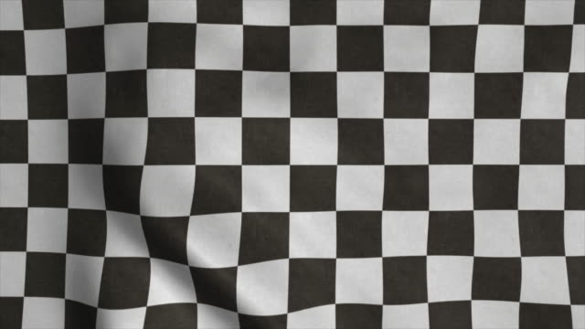 checkered racing flag. racing chequered flag waving in wind - a quadri video stock e b–roll