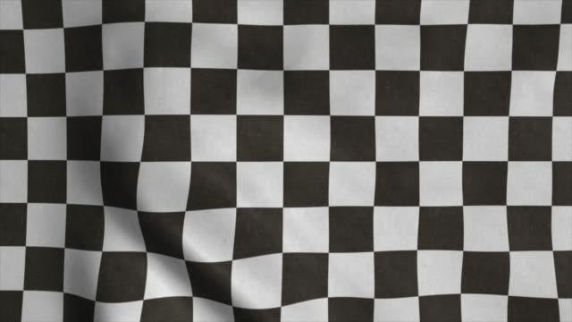 karierte racing-flagge. racing chequered flagge winken im wind - karo stock-videos und b-roll-filmmaterial