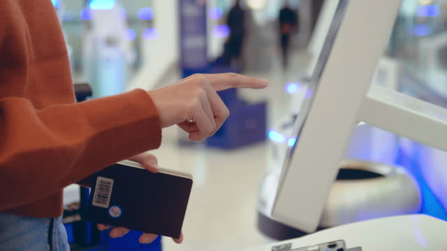 check-in at the airport with self-service machine - stand video stock e b–roll