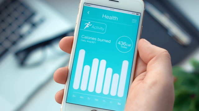 checking activity monitoring on health app on the smartphone - computer indossabile video stock e b–roll