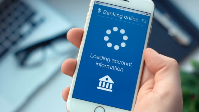 checking bank account on banking app on the smartphone - online banking video stock e b–roll