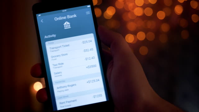 checking banking activity using banking app - online banking video stock e b–roll
