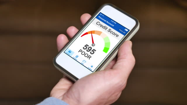 Checking Credit Score on Smartphone Poor A man checks his credit score on his smartphone. The result is poor. Fictional device and screen interface. negative emotion stock videos & royalty-free footage