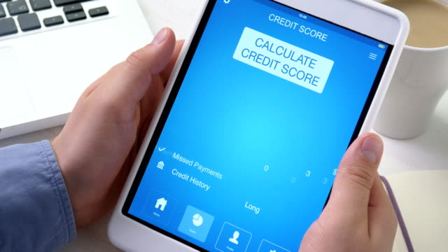 Checking excellent credit score on digital tablet video