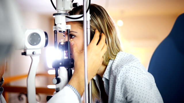 Checking eyesight in a clinic. Ophthalmology. Medicine and health concept. video