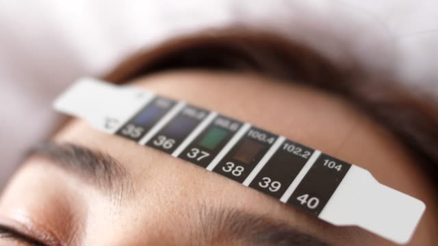 checking fever - alto video stock e b–roll