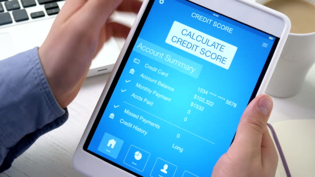 Checking good credit score on digital tablet video