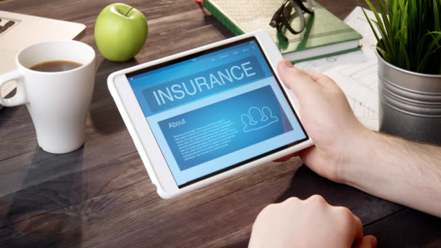 checking insurance info using digital tablet at desk - icon set healthy video stock e b–roll