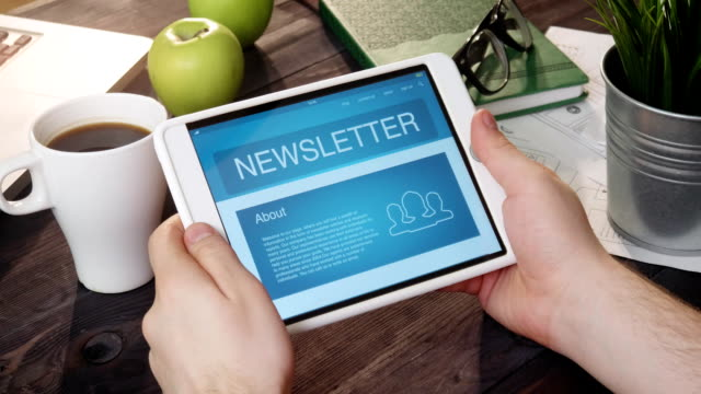 checking newsletter landing page using tablet computer - newsletter video stock e b–roll