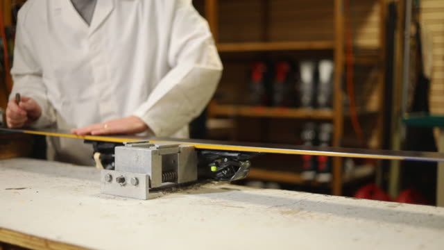 checking repair in ski rental and repair shop in various stages of production series - negozio sci video stock e b–roll