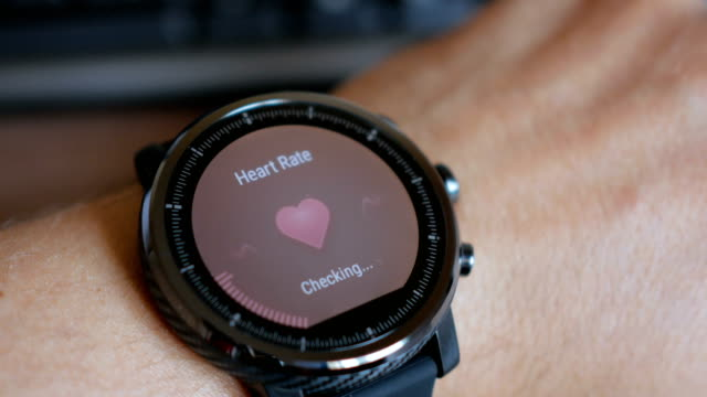 Checking the heart rate by smart watch. Smartwatch. Touching screen. Pulse checking. heart rate monitor Checking the heart rate by smart watch. Smartwatch. Touching screen. Pulse checking. heart rate monitor healthy lifestyle stock videos & royalty-free footage