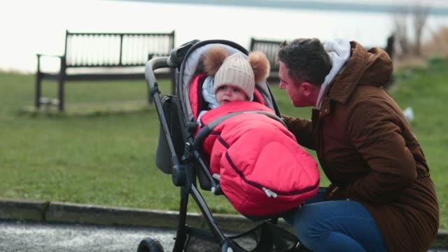 checking up on his baby boy - abiti pesanti video stock e b–roll