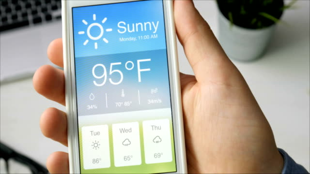 checking wather using smartphone app. hot and sunny weather. - meteorologia video stock e b–roll