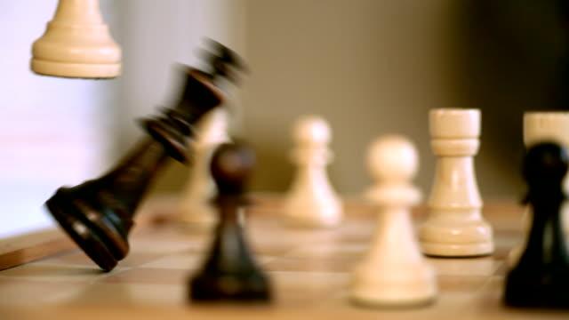 Checkmate. Player knocks down king. video