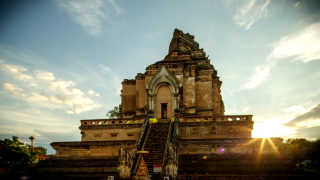 Chedi Luang Pagoda, Sunrise at Wat Chedi Luang Temple with cloudy sky and lens flare - Chiang mai, Thailand video