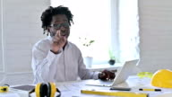 istock Cheerful African Architecture Engineer Pointing with Finger in Office 1219574442