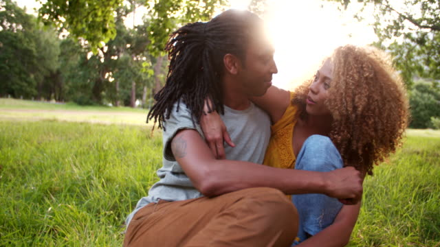 Cheerful African-American couple enjoying a day out at the park video