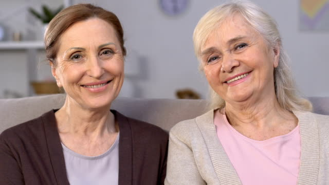 Cheerful aged women smiling at camera, dental implants, healthy teeth, care Cheerful aged women smiling at camera, dental implants, healthy teeth, care implant stock videos & royalty-free footage