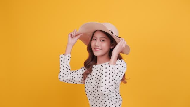 cheerful asia woman with hat giving mini heart - cultura coreana video stock e b–roll