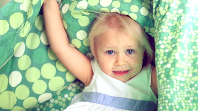 Cheerful baby girl playing hide and seek. Full HD Video video