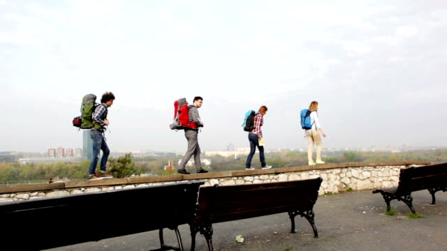 HD: Cheerful Backpackers Walking On The Wall. video