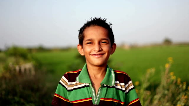 Cheerful boy portrait in the nature video