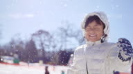 istock Cheerful child playing in the snow 1200167322