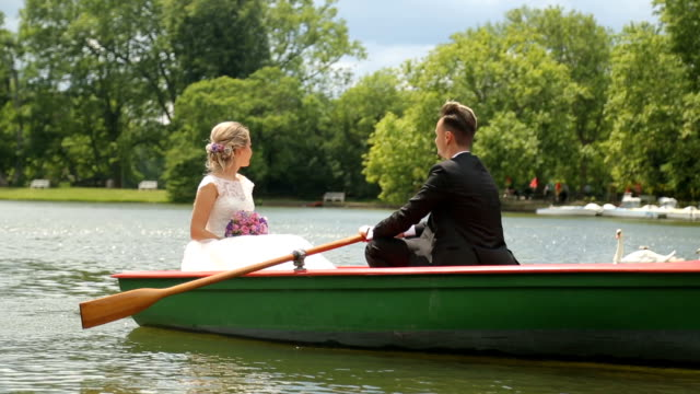 Cheerful couple is paddling on their wedding day