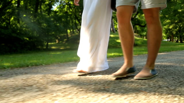 Cheerful couple is taking a walk in the park.
