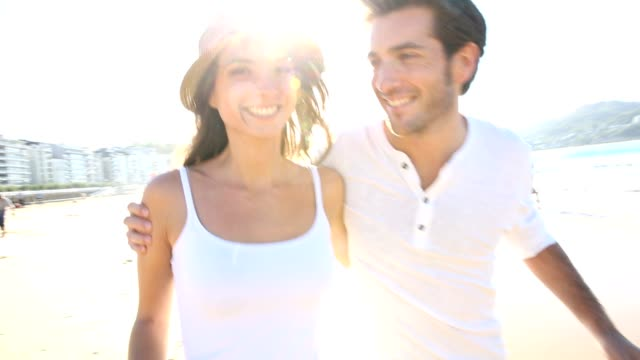 Cheerful couple on the beach video