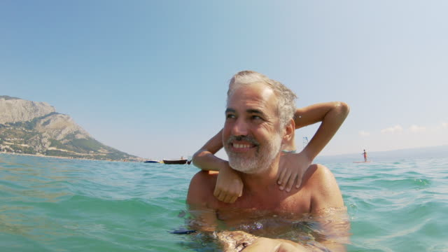 cheerful father and daughter enjoying in sea on summer vacations - nuoto mare video stock e b–roll