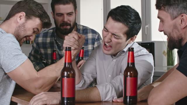 Cheerful Friends Arm Wrestling video
