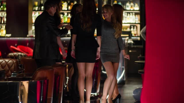 Cheerful friends dancing in nightclub video