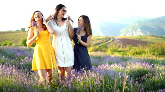Cheerful friends in lavender field