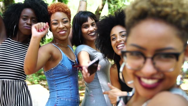Cheerful friends taking selfie Diversity party social event stock videos & royalty-free footage
