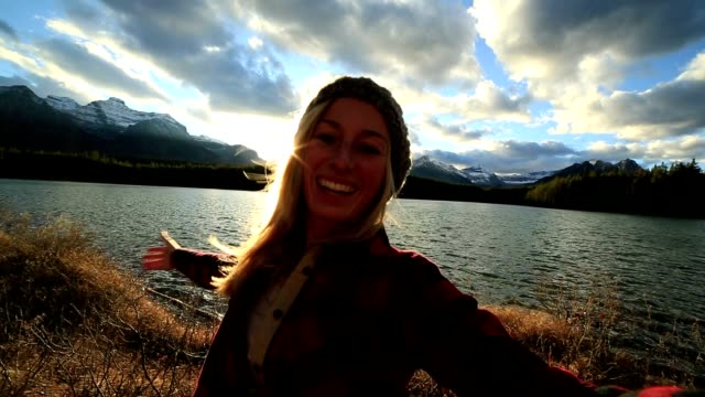 Cheerful girl capturing beautiful moments in nature video