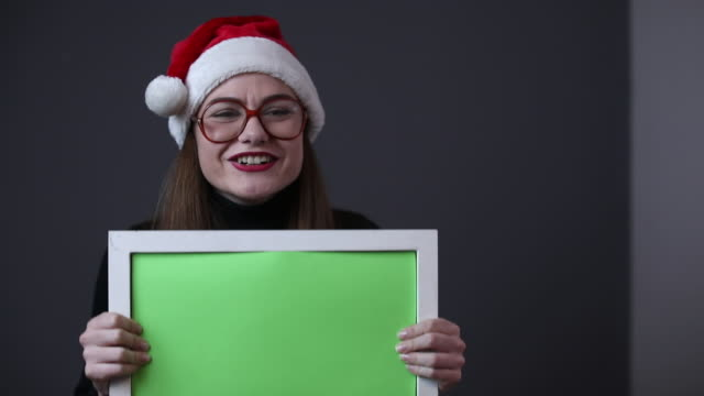 Cheerful girl with Santa's hat