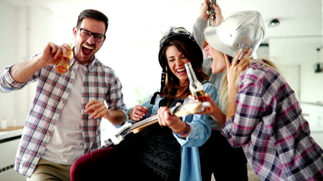 Cheerful happy group of friends having fun video