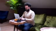istock Cheerful hipster working from a cafe 1153619805