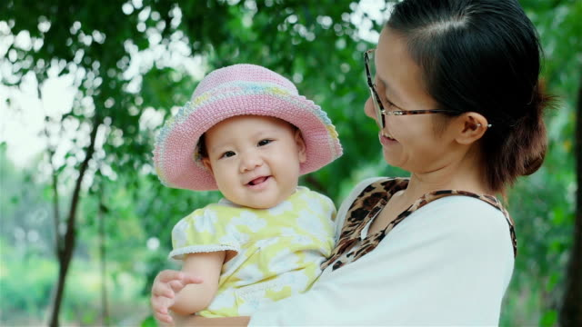 Cheerful Little Asian Baby Girl and her Mother video
