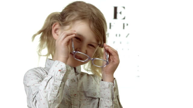 HD: Cheerful Little Girl Putting On Glasses video