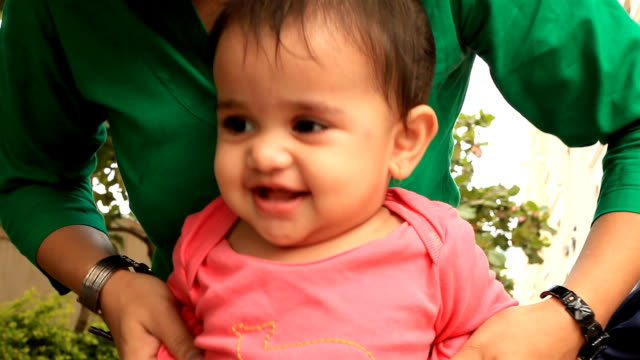 Cheerful Little Indian Girl and her Mother HD 1080: Cheerful Little Indian Girl and her Mother indian family stock videos & royalty-free footage