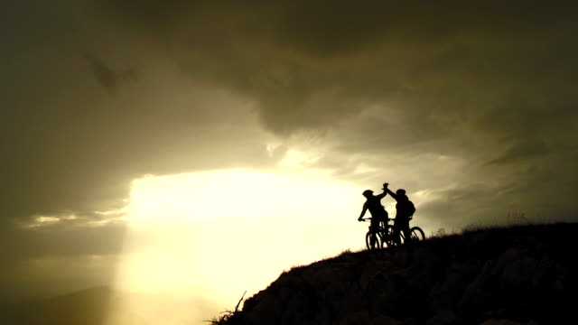 HD CRANE: Cheerful MTB Cyclists On The Top Of Mountain video